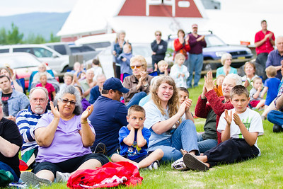 Scores of people listen to the Red Hackle Pipe Band during the kick-off event of Summer Sessions' Music in the Garden Series at the Georgeson Botanical Garden.  Filename: LIF-12-3426-72.jpg