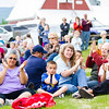 """Scores of people listen to the Red Hackle Pipe Band during the kick-off event of Summer Sessions' Music in the Garden Series at the Georgeson Botanical Garden.  <div class=""""ss-paypal-button"""">Filename: LIF-12-3426-72.jpg</div><div class=""""ss-paypal-button-end"""" style=""""""""></div>"""