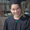 """Senior foreign languages major Lindsey Miller poses in her cap and gown on the roof of the Brooks Building on the Fairbanks campus.  <div class=""""ss-paypal-button"""">Filename: LIF-12-3352-6.jpg</div><div class=""""ss-paypal-button-end"""" style=""""""""></div>"""