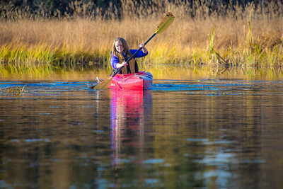 Business major Shelby Carlson enjoys a morning paddle on Ballaine Lake.  Filename: LIF-12-3562-070.jpg