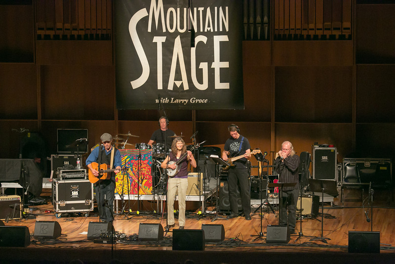 "The Fairbanks duo of Pat Fitzgerald, left, and Robin Dale Ford, center, performed along with backup musicians during one of two live recorded performances of the nationally broadcast radio show Mountain Stage in the Davis Concert Hall Aug. 17 and 18. The shows were sponsored by UAF Summer Sessions and KUAC-FM.  <div class=""ss-paypal-button"">Filename: LIF-12-3502-297.jpg</div><div class=""ss-paypal-button-end"" style=""""></div>"