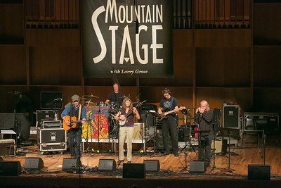 The Fairbanks duo of Pat Fitzgerald, left, and Robin Dale Ford, center, performed along with backup musicians during one of two live recorded performances of the nationally broadcast radio show Mountain Stage in the Davis Concert Hall Aug. 17 and 18. The shows were sponsored by UAF Summer Sessions and KUAC-FM.  Filename: LIF-12-3502-297.jpg
