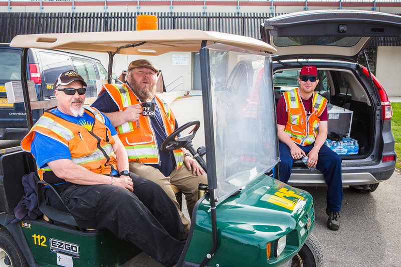 "Facilities Services staff sit in the sidelines during the 2016 Really Free Market on the Fairbanks campus.  <div class=""ss-paypal-button"">Filename: LIF-16-4909-2.jpg</div><div class=""ss-paypal-button-end""></div>"