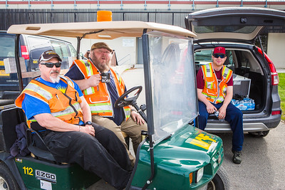 Facilities Services staff sit in the sidelines during the 2016 Really Free Market on the Fairbanks campus.  Filename: LIF-16-4909-2.jpg