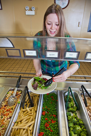 Junior Anastasia Brease loads up on vegetables during lunch in the Lola Tilly Commons.  Filename: LIF-11-3220-093.jpg