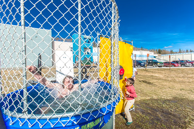 This participant took matters into his own hand after missing with previous efforts at the dunk tank which was one of the attractions set up during SpringFest Field Day Apri 28.  Filename: LIF-14-4168-309.jpg