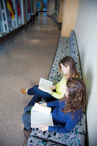 Megan Gilmore (back) and Ashley Bartolowits (front) study in the hallway of the Syun-Ichi Akasofu building on campus.  Filename: LIF-11-3242-025.jpg