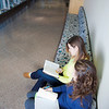 "Megan Gilmore (back) and Ashley Bartolowits (front) study in the hallway of the Syun-Ichi Akasofu building on campus.  <div class=""ss-paypal-button"">Filename: LIF-11-3242-025.jpg</div><div class=""ss-paypal-button-end"" style=""""></div>"