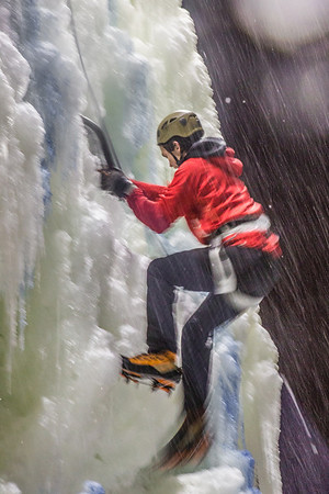 A competitor makes his way to the top of the ice wall during a climbing contest on March 1.  Filename: LIF-13-3748-171.jpg