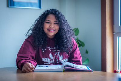 Kisha Lee, majoring in rural human services at UAF's Kuskoskim Campus in Bethel, studies in the student lounge on campus.  Filename: LIF-16-4859-126.jpg