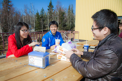Ruonan Wu (left) Liang Li (center) Zhenzihao Zhang (right) enjoy lunch on the Wood Center deck.  Filename: LIF-12-3356-158.jpg