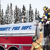 "Spencer McLean hands a rolled up fire hose to Aaron Stevens after filling an outdoor ice rink for children at Ice Alaska's George Horner Ice Park in Feb. 2013.  <div class=""ss-paypal-button"">Filename: LIF-12-3723-233.jpg</div><div class=""ss-paypal-button-end"" style=""""></div>"