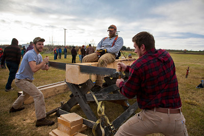 Jamie Hollingsworth (center) times students Ethan Stephens (left) and  Joe Hunner (right) participated in the 2011 Farthest North Forest Sports Festival hosted by the UAF School of Natural Resources & Agricultural Sciences.  Filename: LIF-11-3185-90.jpg