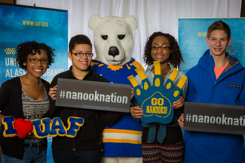 """Parents and prospective students pose with the UAF mascot during the Fall 2015 Inside Out event hosted by UAF's office of admissions and the registrar.  <div class=""""ss-paypal-button"""">Filename: LIF-14-4353-39.jpg</div><div class=""""ss-paypal-button-end""""></div>"""