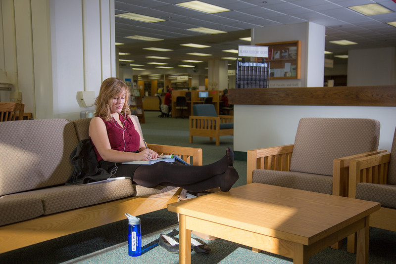 """Music education major Anna Polum finds a comfortable spot to study in the Rasmuson Library.  <div class=""""ss-paypal-button"""">Filename: LIF-13-3950-69.jpg</div><div class=""""ss-paypal-button-end"""" style=""""""""></div>"""