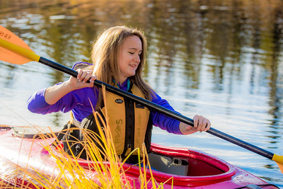 Business major Shelby Carlson enjoys a morning paddle on Ballaine Lake.  Filename: LIF-12-3562-075.jpg