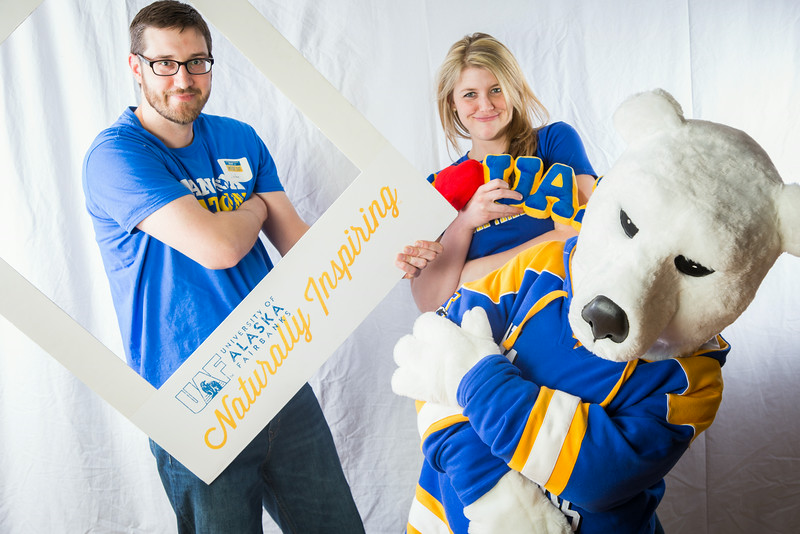 """Admissions counselors John Smelter and Caitlin Kaber strike a pose with the Nook during UAF's InsideOut event in the Wood Center ballroom.  <div class=""""ss-paypal-button"""">Filename: LIF-14-4117-3.jpg</div><div class=""""ss-paypal-button-end""""></div>"""