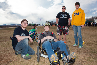 Electrical Engineering major Isaac Thompson (left) and Mechanical Engineering major Karlin Swearingen (second right) demonstrate their electronic powered tricycles to other students during the 2012 Spring Fest field day activities.  Filename: LIF-12-3384-69.jpg