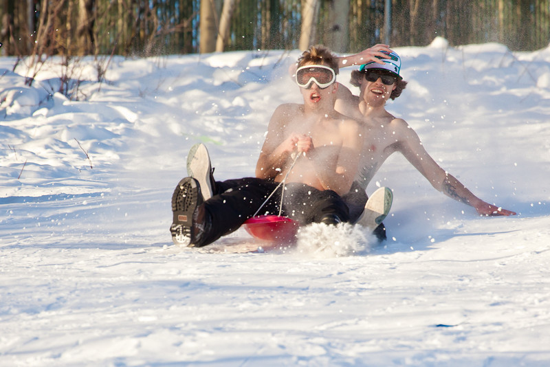 """Bryan Johnson, front, and his buddy Jimmy Donohue spend some quality time on the UAF sledding hill on a nice February afternoon.  <div class=""""ss-paypal-button"""">Filename: LIF-12-3290-61.jpg</div><div class=""""ss-paypal-button-end"""" style=""""""""></div>"""