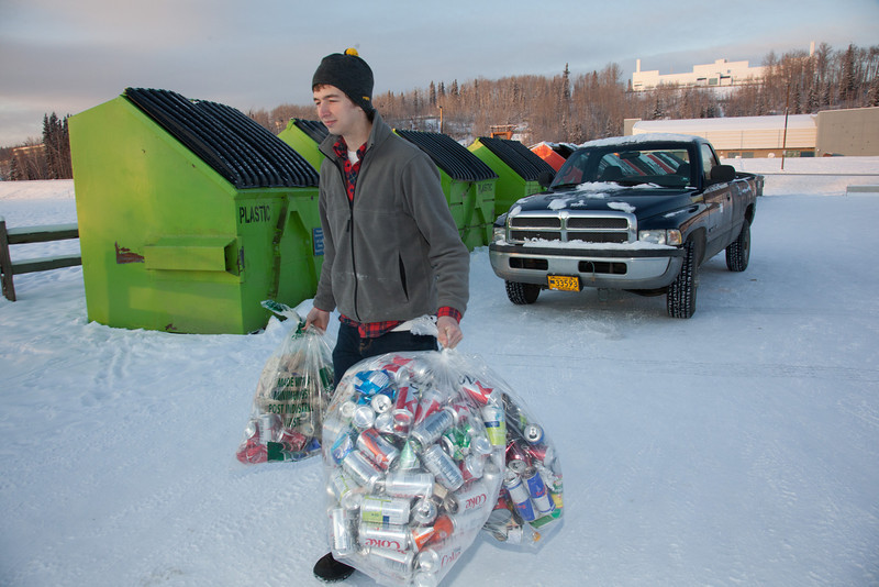 "Brandon Hoover loads aluminum cans from the MBS residence hall complex into the campus recycle bins.  <div class=""ss-paypal-button"">Filename: LIF-11-3210-03.jpg</div><div class=""ss-paypal-button-end"" style=""""></div>"