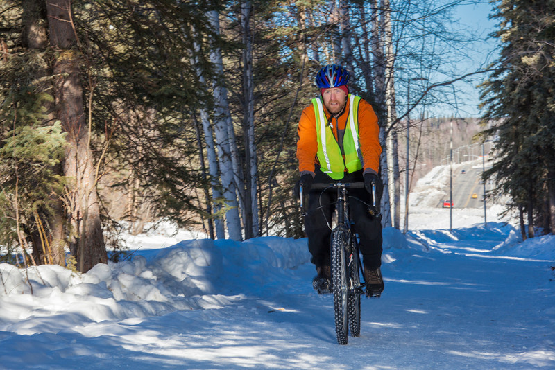 """Frank Olive, assisant coordinator of programming for UAF Outdoor Adventures, rides his bike to work on campus on a spring afternoon.  <div class=""""ss-paypal-button"""">Filename: LIF-12-3340-23.jpg</div><div class=""""ss-paypal-button-end"""" style=""""""""></div>"""