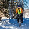 "Frank Olive, assisant coordinator of programming for UAF Outdoor Adventures, rides his bike to work on campus on a spring afternoon.  <div class=""ss-paypal-button"">Filename: LIF-12-3340-23.jpg</div><div class=""ss-paypal-button-end"" style=""""></div>"