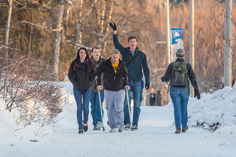 "Students walk and wave along Yukon Drive on the first day of classes in the spring 2013 semester.  <div class=""ss-paypal-button"">Filename: LIF-13-3699-28.jpg</div><div class=""ss-paypal-button-end"" style=""""></div>"