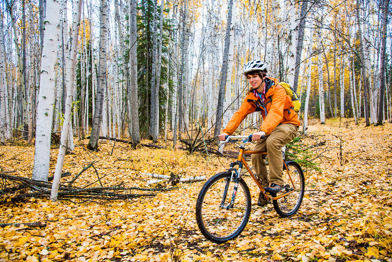 """Mechanical engineering major Adam McCombs rides his bike through the woods towards campus on a recent foggy morning.  <div class=""""ss-paypal-button"""">Filename: LIF-12-3556-138.jpg</div><div class=""""ss-paypal-button-end"""" style=""""""""></div>"""
