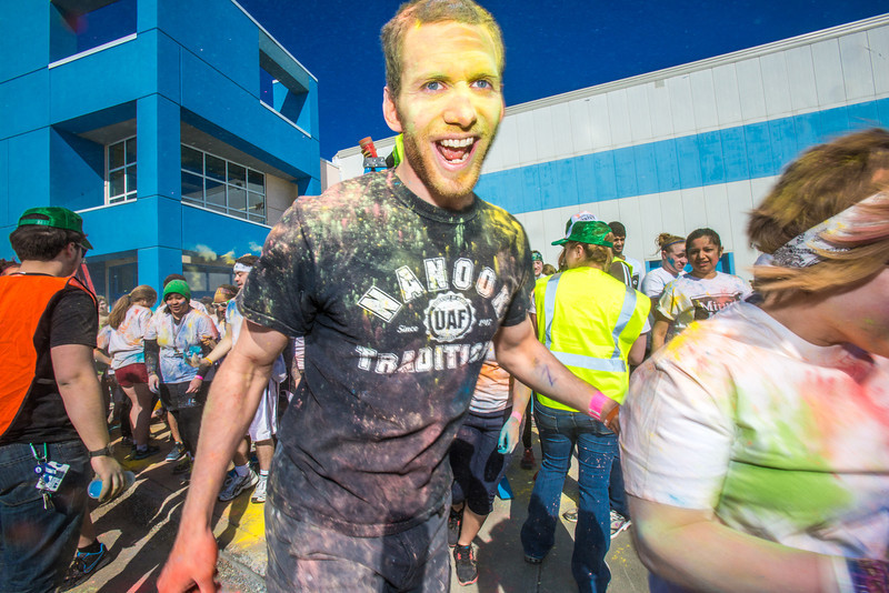 """Students enjoy getting doused with colored dye before participating in a 5-kilometer run during SpringFest on the Fairbanks campus.  <div class=""""ss-paypal-button"""">Filename: LIF-13-3805-84.jpg</div><div class=""""ss-paypal-button-end"""" style=""""""""></div>"""