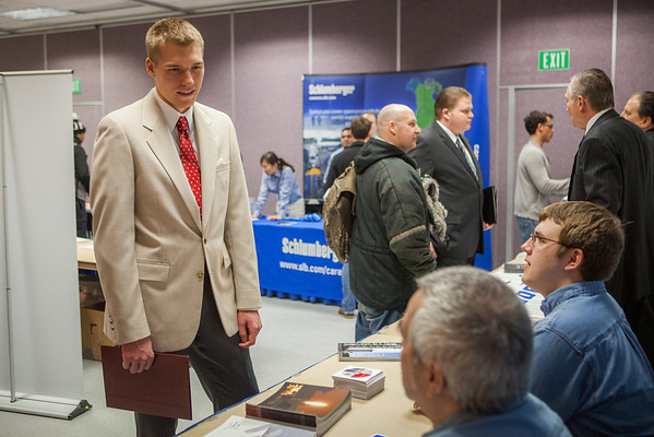 """Caleb Smith speaks to potential summer internship opportunities at the at the Student Job and Internship Fair provided by UAF Career Services.  <div class=""""ss-paypal-button"""">Filename: LIF-13-3745-7.jpg</div><div class=""""ss-paypal-button-end"""" style=""""""""></div>"""