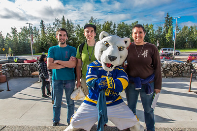 Returning students, staff and parents all pitch in to help new arrivals move into the residence halls during Rev It Up on the Fairbanks campus at the beginning of the fall 2015 semester.  Filename: LIF-15-4636-078.jpg