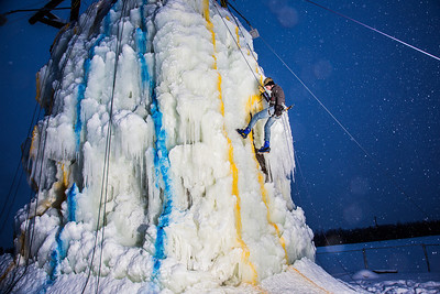 A competitor descends from the top of the ice wall in after his climb during a fun event on March 1.  Filename: LIF-13-3748-23.jpg