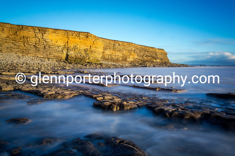 Sun setting on the cliffs from Nash Point.