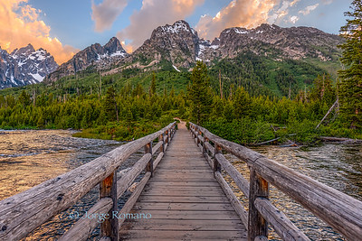 Wooden bridge over the Snake River with the Grand Teton Mountains