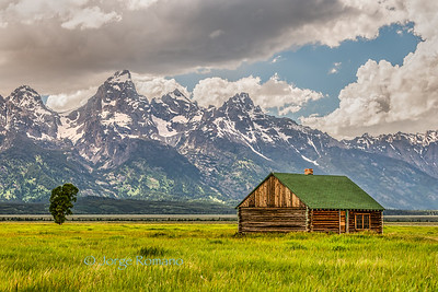 Historic Mormon Ranch and Grand Teton Mountains in a cloudy morning, Wyoming, USA