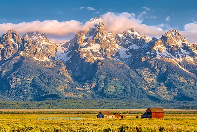 Historic Mormon Ranch and Grand Teton Mountains early morning, Wyoming, USA.