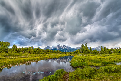 Dark clouds over Grand Teton mountains and Snake River