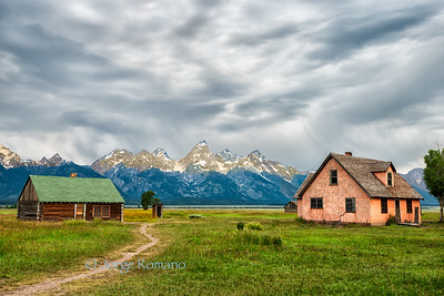 Historic Mormon Ranch in the early morning with the Grand Teton Range in the background