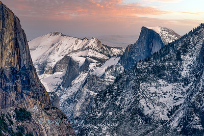 View of Half Dome and part of El Capitan in Yosemite Valley after a snow storm at sunset