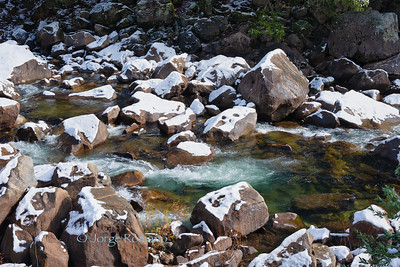 Rocks with snow in the Merced River, Yosemite National Park