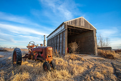 Barn and Tractor at Sunrise