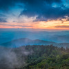 The end of the day brings the distant light across the Appalachian  Mountains on the Blue  Ridge Parkway in Western North Carolina.