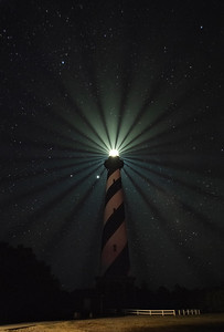 The long still day is ending In hollow and on height,  The lighthouse seaward sending  White rays of steady light;  - Roderic Quinn  Hatteras Lighthouse's (stacked) beams of light - Cape Hatteras National Seashore, North Carolina
