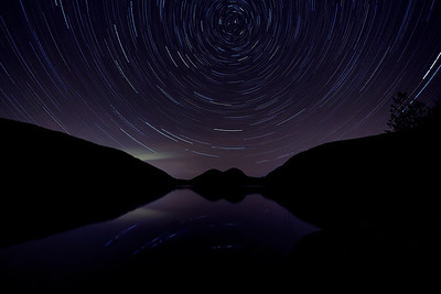 Star trail over The Bubbles at Jordan Pond - Acadia National Park, Maine  (The light green hue shooting out is a bit of   Aurora Borealis unexpectedly captured.)