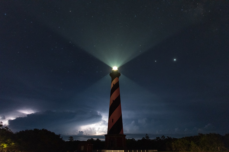 Hatteras Lighthouse with approaching thunderstorm from the north. - Cape Hatteras National Seashore, North Carolina