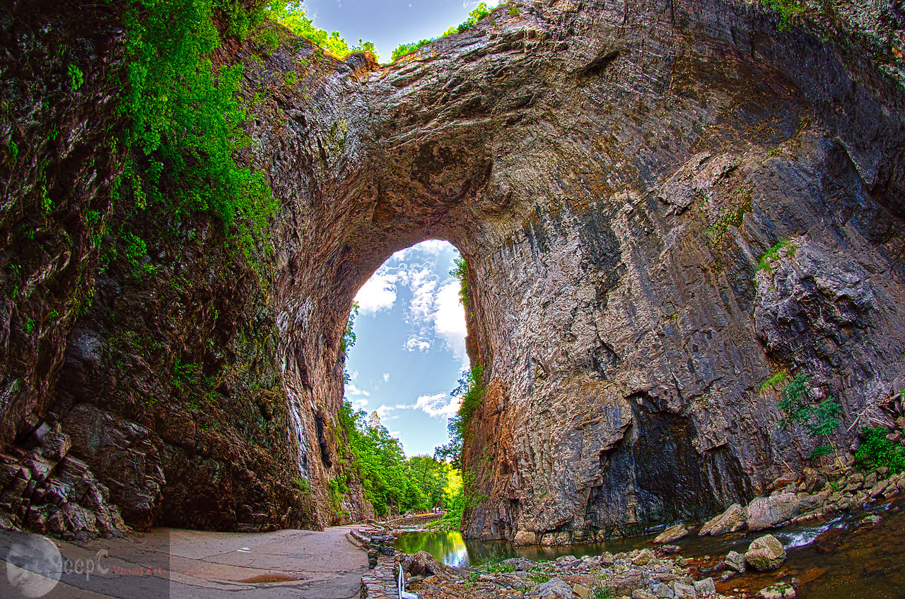 Natural Bridge<br /> Place : Virginia USA.<br /> <br /> This photograph is taken at Natural Bridge VA USA. It is formed Naturally. The biggest challenge of nature photography is to get each and every detail which can be seen by your bare eyes. I had to capture 5 exposures to get every detail. If you observe closely you will see a lot details in darks and highlights.
