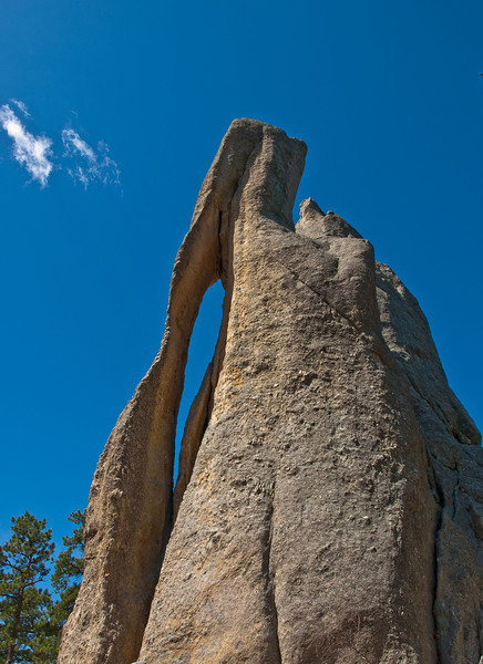 Needles Eye in South Dakota. You have to travel the Needles Highway to get to this location. Needles Highway is a very small road with Low Narrow Tunnel's that had width's of 9 feet and Height's of 12 feet.