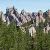 This formation is called Cathedral Spires which is located in the Custer State Park in the Black Hills of South Dakota. To get to this location you must travel the Needles Highway which has low Narrow Tunnels that had widths of about 9 feet and Height of 12 feet. This road is nice to drive because you have no large Motor Homes or large trailers to deal with. A lot of Motor Bikes doing back country scenic travel.