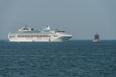 Cruise Ship Approaches Lighthouse