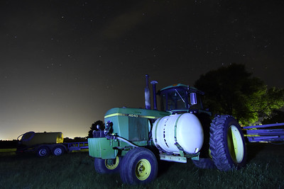 Farm Equipment Under a Starry Sky